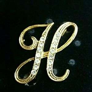 Vintage gold initial H brooch with white crystals